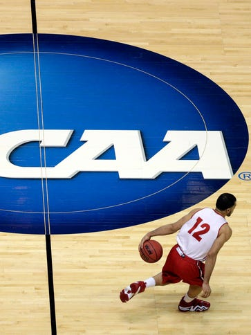 Wisconsin's Traevon Jackson dribbles past the NCAA