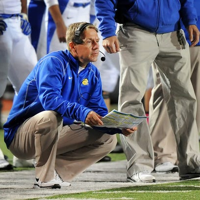 Carmel head coach Kevin Wright watches his team in the first half of the game held at Ben Davis High School on Friday, October 18, 2013. Matt Detrich / The Star