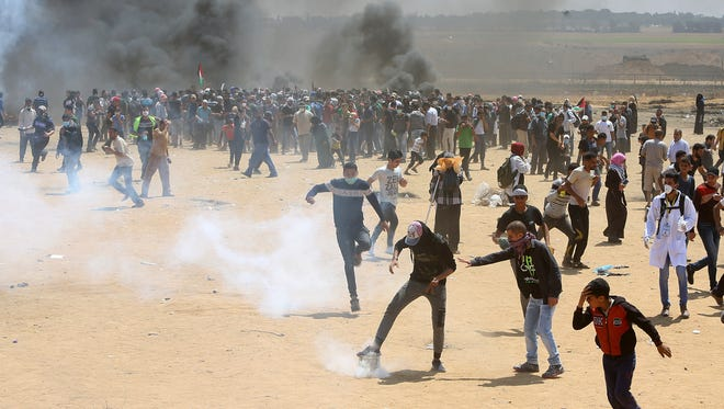 Palestinian protesters burn tires near the Israeli border fence, east of Khan Younis, in the Gaza Strip on Monday.