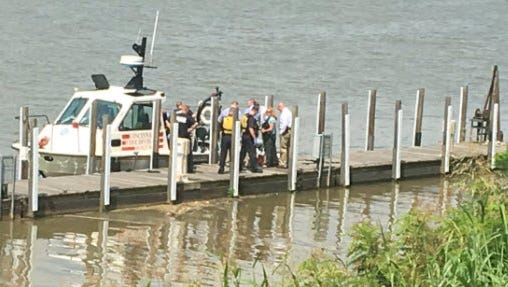Crews recover a body from the Ohio River on Wednesday