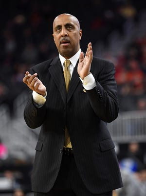 Mar 8, 2017: Washington Huskies head coach Lorenzo Romar applauds during a Pac-12 Conference Tournament game against the USC Trojans at T-Mobile Arena.