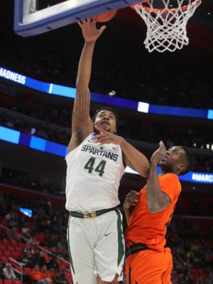 Michigan State forward Nick Ward shoots over Bucknell center Nana Foulland during the first half of the NCAA tournament Friday, March 16, 2018 at Little Caesars Arena in Detroit MI.