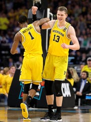 Moritz Wagner and Charles Matthews celebrate Michigan's