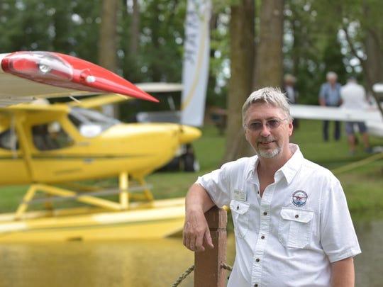 Paul Seehafer, EAA volunteer chairman, operates the Oshkosh Seaplane Base during the week-long EAA AirVenture in Oshkosh, Wis.
