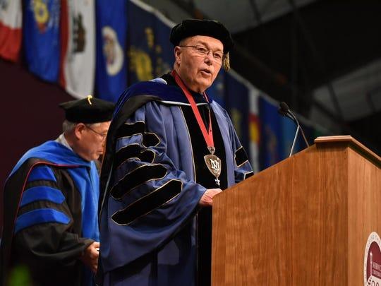Norwich University President Richard Schneider addresses the graduates Saturday.