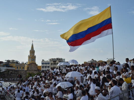 Some of the 2,500 people who were invited to wear white and witness the signing of the historic peace agreement between the Colombian government and the Revolutionary Armed Forces of Colombia (FARC) in Cartagena on Sept. 26, 2016.