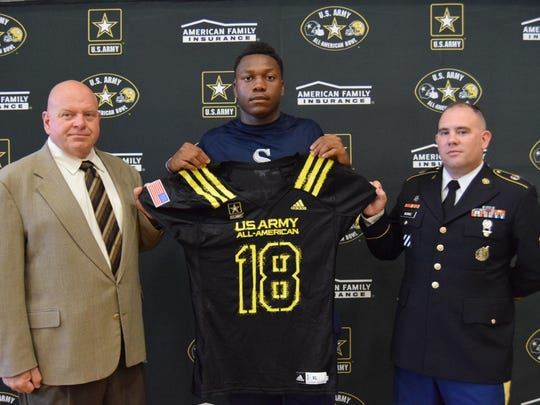 Justin Mascoll presented with Army Bowl jersey. (Photo: AAG)