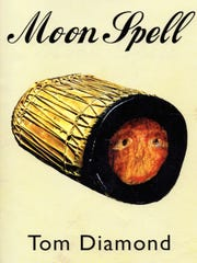 """""""Moon Spell"""" by Tom Diamond is a series of autobiographical vignettes from the longtime El Paso lawyer. The cover shows face drawn on an ancient drum owned by a governor of the Tigua Indians."""