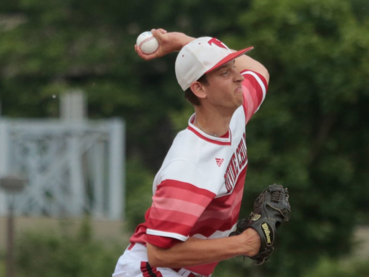 Jonathan Lapshan of Dearborn Divine Child throws a pitch to Orchard Lake St. Mary during the 2015 MHSAA Baseball quarterfinals on Tuesday June 9, 2015 at Wayne State University in Detroit.
