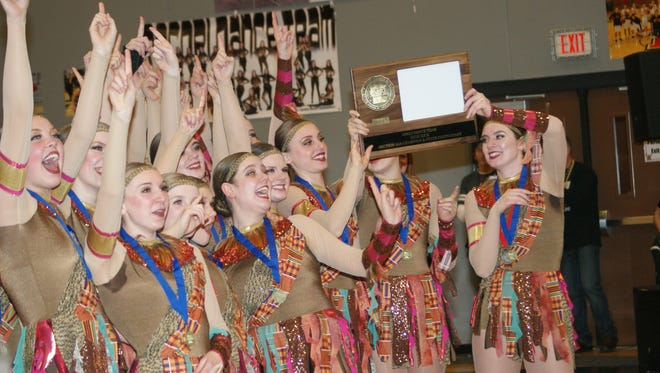 The Sartell dance team accepts its trophy for taking first in high kick at the Section 4-2A championships Feb. 4 at Rocori High School in Cold Spring.