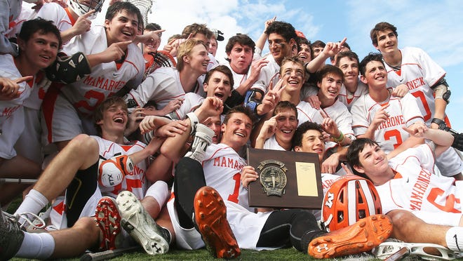 Mamaroneck players celebrate their 12-11 overtime victory over Mahopac in the Section 1 Class A boys lacrosse final Thursday at White Plains High School.