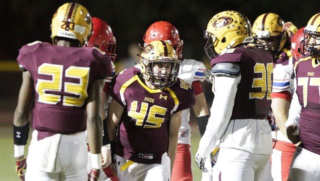 Phoenix Mountain Pointe junior LB Jacob Olsen (45) celebrates after a tackle at Mountain Pointe High School in Phoenix on Friday, Sept. 16, 2016.