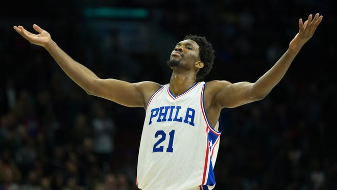 Philadelphia 76ers center Joel Embiid (21) reacts as time winds down on a victory against the Miami Heat at Wells Fargo Center. The Philadelphia 76ers won 101-94.