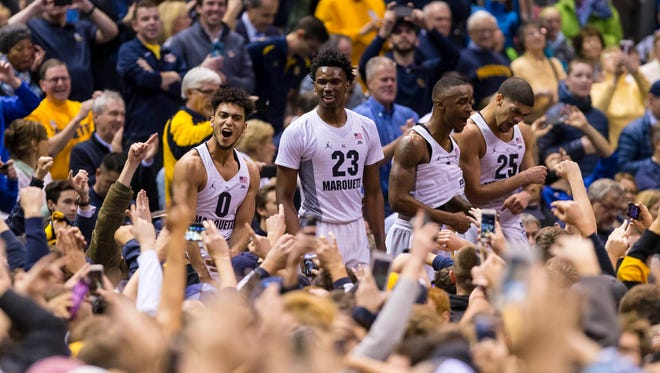 Jan 24, 2017; Milwaukee, WI, USA; Marquette Golden Eagles players celebrate with fans after their game against the Villanova Wildcats at BMO Harris Bradley Center. The Golden Eagles won 74-72.
