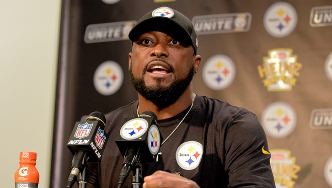 Pittsburgh Steelers head coach Mike Tomlin answers questions at his post-game meeting with reporters following a 29-14 win over the Cincinnati Bengals in an NFL football game in Pittsburgh, Sunday, Oct. 22, 2017. Tomlin says the Steelers have no plans to trade disgruntled wideout Martavis Bryant.