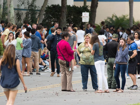 Students, faculty, and staff of Naples High School are evacuated to the nearby Coastland Center Mall parking lot after a bomb threat was received at the school around 9 a.m. this morning Thursday, March 2, 2017 in Naples.