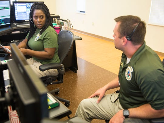 Dispatchers Adam Biggs, right, and LeWanna House came from Hamilton County in Tennessee to help with the high volume of emergency calls received in the wake of Hurricane Irma at the Collier County Emergency Services Center on Friday September 22, 2017.