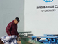 New America School student Ajay Avalos hauls trash