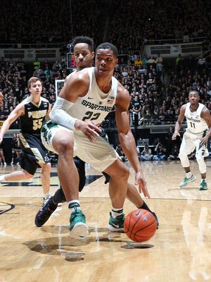 Feb 18, 2017; West Lafayette, IN, USA; Michigan State Spartans forward Miles Bridges is guarded by Purdue Boilermakers forward Vincent Edwards at Mackey Arena.