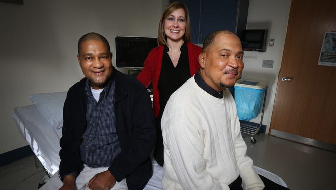 Brothers Aaron Arnold, left, and Kenneth Catlett, right, had heart transplants at the University of Kentucky one year apart and were reunited wafter not seeing each other for 20 years when a nurse, Donna Dennis, unknowingly brought one to see the other to allay surgery fears.December 18, 2015