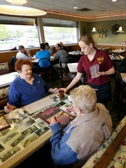 Twin City Diner will continue to operate normally in Neenah now that Aldi no longer wants to buy and tear down the building. Here, Twin City Diner employee Spresa Bekteshi serves coffee Tuesday to Dorothy Mack, left, of Appleton and Jane Arps of Neenah.