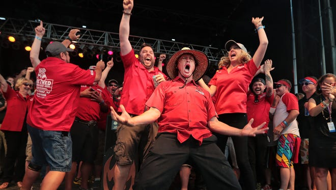 Brad Orrison celebrates with his team after The Shed took home a purse of about $34,000, coming out on top of Big Bob Gibson's Bar-B-Q and 10 Bones BBQ to win the Grand Championship at the 2019 Memphis in May World Championship Barbecue Cooking Contest at Tom Lee Park.