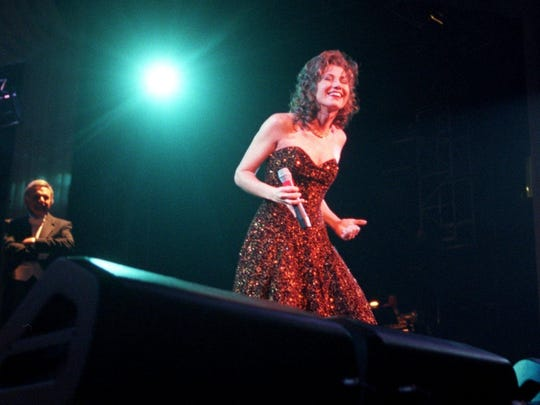 Amy Grant laughs during Tennnessee Christmas, which opened Nashville Arena on Dec. 18, 1996.