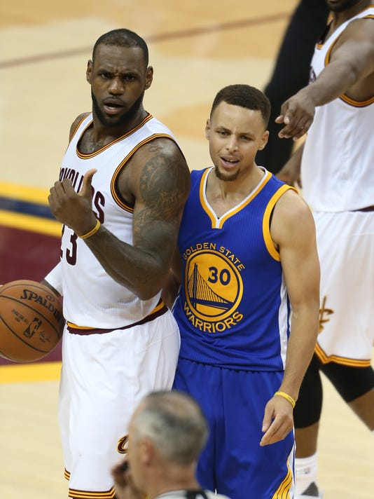 Golden State Warriors guard Stephen Curry reacts to being called for his sixth foul on Cleveland Cavaliers forward LeBron James (23) during the second half of Game 6 of basketball's NBA Finals in Cleveland, Thursday, June 16, 2016. (AP Photo/Ron Schwane)