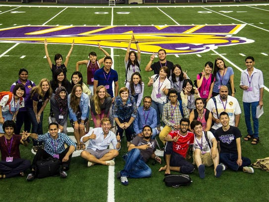 A group of international students pose for a photo