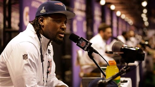 New England Patriots' LeGarrette Blount answers questions during media day for NFL Super Bowl XLIX football game Tuesday in Phoenix.