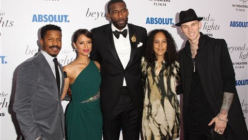 """In this file photo, from left, actor Nate Parker, actress Gugu Mbatha-Raw, N.Y. Knicks player and producer Amar'e Stoudemire, director Gina Prince-Bythewood and rapper Colson """"MGK"""" Baker attend the premiere of """"Beyond The Lights"""" at the Regal Union Square in New York. The movie is about a young pop star who finds love and a fresh perspective outside the spotlight."""