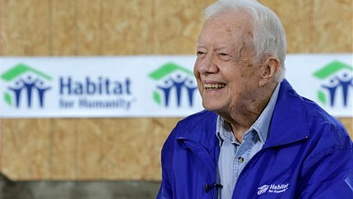 In this Nov. 1, 2015 photo, former President Jimmy Carter is interviewed at a Habitat for Humanity project site in Memphis, Tenn. Carter said it's too soon to tell whether treatment he received for his brain cancer has been effective, but that he hasn't been uncomfortable or ill while receiving rounds of immune-boosting drugs. (AP Photo/Mark Humphrey)