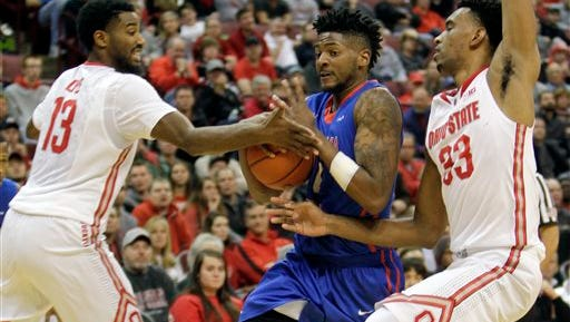 Louisiana Tech's Alex Hamilton, center, drives to the basket between Ohio State's JaQuan Lyle, left, and Keita Bates-Diop during the second half of an NCAA college basketball game Tuesday, Nov. 24, 2015, in Columbus, Ohio. Louisiana Tech beat Ohio State 82-74.(AP Photo/Jay LaPrete)