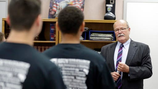Democratic Indiana gubernatorial candidate John Gregg speaks with students as the toured the J. Everett Light Career Center, Monday, Sept. 19, 2016, in Indianapolis. (AP Photo/Darron Cummings)