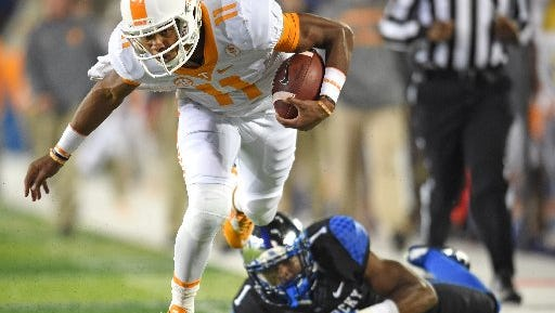 Joshua Dobbs eludes a Kentucky tackler last season.