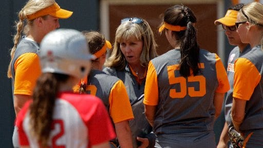Tennessee co-head softball coach Karen Weekly talks to her players during an NCAA regional game against Ohio State on May 22.