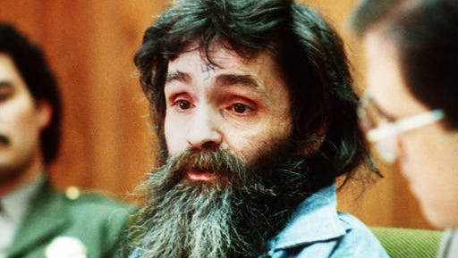 FILE - In this 1986 file photo, Charles Manson is seen in court. Amid reports that Charles Manson has been taken from his California prison cell to a hospital, a state corrections official would confirm only that the 82-year-old killer and cult leader was still alive. Both TMZ and the Los Angeles Times reported Tuesday, Jan. 3, 2017 that Manson had been hospitalized.