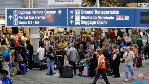 Baggage claim area of Terminal 1 at Fort Lauderdale-Hollywood International Airport on Saturday, Jan. 7, 2017 the day after multiple people were shot at the airport. (Al Diaz/Miami Herald via AP)