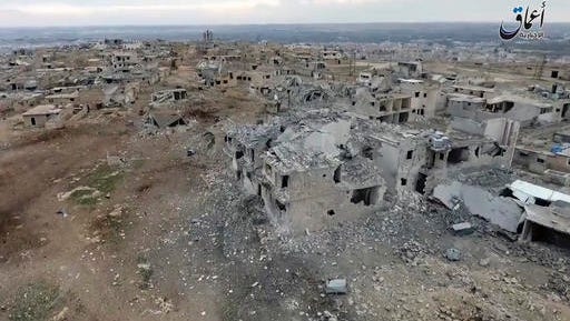 This still image taken from drone footage posted online Monday, Jan. 2, 2017 by the Aamaq News Agency, a media arm of the Islamic State group, purports to shows an aerial image of a neighborhood damaged by Turkish airstrikes in the northern Syrian town of al-Bab, in Aleppo province, Syria. Nearly two months into the assault, Turkey has become bogged down in an unexpectedly bloody fight to retake the Islamic State group's last stronghold in northern Syria. It has been forced to pour in troops, take the lead in the battle from its Syrian allies and reach out to Russia for aerial support -- a move that tests its alliance with the United States and the Syrian opposition.