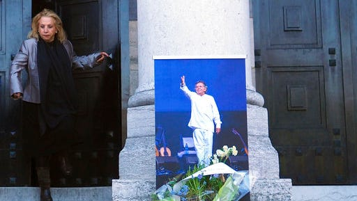 A picture of Chilean singer and songwriter Angel Parra, is displayed at the entrance of a chapel, at the Pere Lachaise cemetery, in Paris, Thursday, March 16, 2017.  Exiled Chilean musician and son of the singer Violeta Parra,  Angel Parra died in Paris on March 11, aged 73 and has been buried in Paris' largest cemetery.