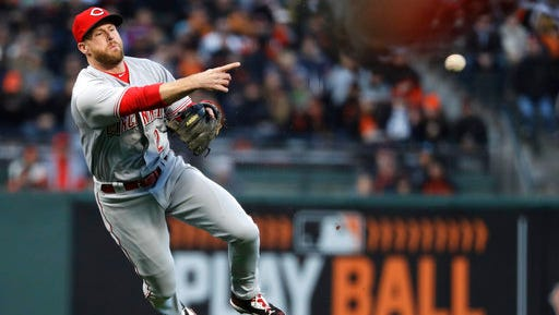 Reds shortstop Zack Cozart was given Saturday off after Friday's 17-inning marathon in San Francisco.