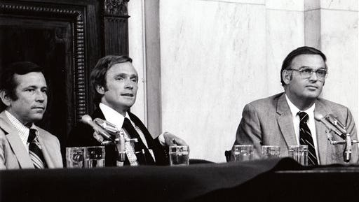 """This Aug. 1, 1973 photo released by PBS shows host Dick Cavett of """"The Dick Cavett Show,"""" center, on location in the Senate Watergate Committee hearing room in Washington with Committee Vice-Chairman, Sen. Howard Baker, left, and Sen. Lowell Weicker. PBS is marking the 40th anniversary of President Richard Nixon's resignation by running a documentary on the Watergate scandal seen through the prism of Cavett's late-night talk show at the time. PBS announced Tuesday, July 1, 2014, it would air Aug. 8 at 8 p.m. - 40 years to the hour after Nixon announced to the nation that he was quitting."""