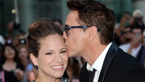 """Actor Robert Downey Jr. and wife producer Susan Downey arrive at opening night gala premiere of """"The Judge"""" during the 2014 Toronto International Film Festival on Thursday in Toronto."""