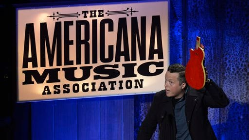 """Jason Isbell accepts the Song of the Year Award for """" Cover Me Up"""" during the Americana Music Honors and Awards show Wednesday in Nashville, Tenn."""