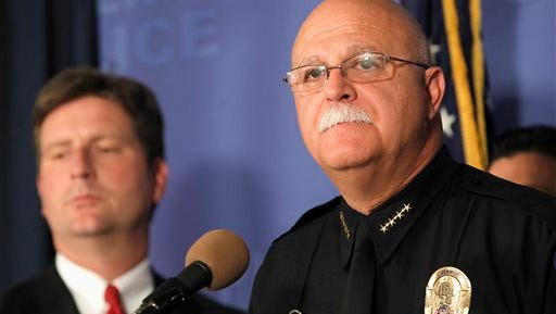 Phoenix Chief of Police Daniel Garcia, right, pauses while speaking at a news conference as Phoenix Mayor Greg Stanton, left, listens in at Phoenix Police Headquarters, on Thursday, June 12, 2014, in Phoenix, speaking about a Wednesday evening attack that left a priest shot and killed and another injured at the Roman Catholic church the Mother of Mercy Mission.  Police have no suspects at this point, but they are canvassing the neighborhood and going over physical evidence from the scene. (AP Photo/Ross D. Franklin)