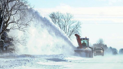 A snowblower clears State Highway 22 near Mapleton, Minn. after a storm Feb. 21.