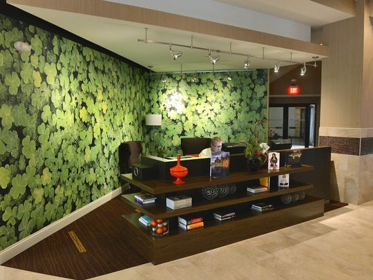 The Courtyard by Marriott includes a lobby-based business center with shamrock wallpaper and a library of at least 26 books.