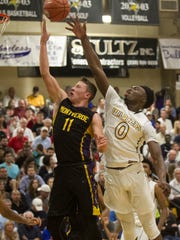 Cameron Jordan, left, and Darius Perry of Wheeler High School celebrate winning the championship game of the 42nd annual Culligan City of Palms Classic on Tuesday, December 23, 2014 at Bishop Verot High School in Fort Myers.