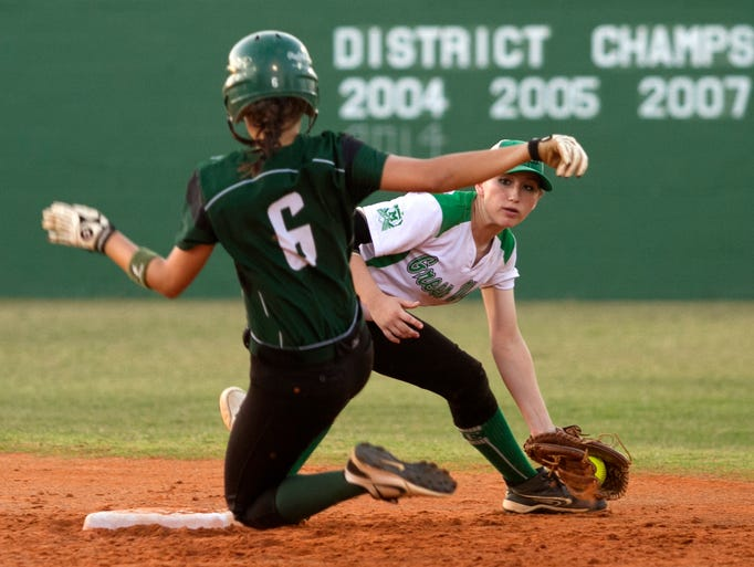 Fort Myers' Jessica Huckeby tries to tag Melbourne's Erina Colombo in the regional softball quarterfinals on Tuesday at Fort Myers High School. Colombo was safe on the play.