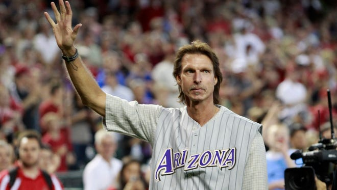PHOENIX, AZ - MAY 18:  Former Arizona Diamondbacks pitcher Randy Johnson waves to fans during a ceremony celebrating the 10th anniversary of his perfect game before the start of a MLB game between the Diamondbacks and Los Angeles Dodgers at Chase Field on May 18, 2014 in Phoenix, Arizona.  (Photo by Ralph Freso/Getty Images)
